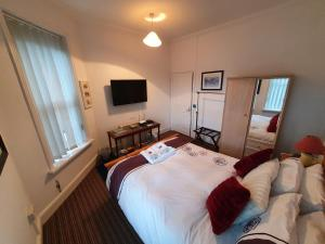 A bed or beds in a room at Apartments Wales