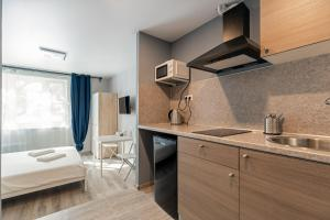A kitchen or kitchenette at RentWill Borovskoe 137-2