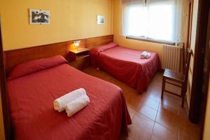 Cama o camas de una habitación en Pension Restaurante Sony