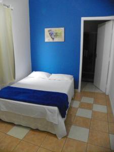 Cama ou camas em um quarto em Santos Hotel