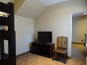 A television and/or entertainment center at Holiday Inn Express Springdale - Zion National Park Area, an IHG Hotel