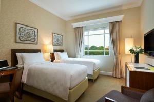 Ein Bett oder Betten in einem Zimmer der Unterkunft Rendezvous Hotel Singapore by Far East Hospitality (SG Clean)