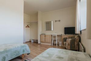 Voodi või voodid majutusasutuse Staadioni Hotel toas