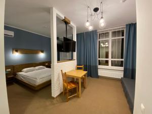 Кровать или кровати в номере Irbis Hotel