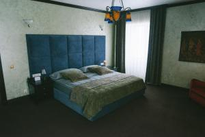 Кровать или кровати в номере Отель Алтай Пэлас