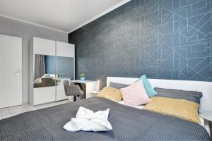 A bed or beds in a room at Vision Aparthotel