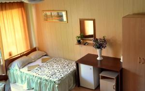 A bed or beds in a room at Domik u Plyazha Guest House