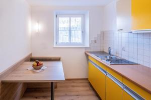 Küche/Küchenzeile in der Unterkunft Apartments Heidenberger Delle Scuole