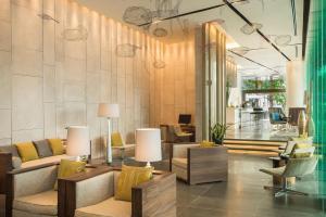 The lobby or reception area at Pullman Saigon Centre
