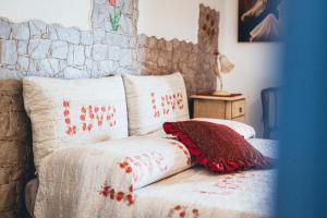 Letto o letti in una camera di Villa Tonia