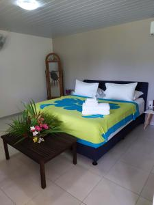 Cama ou camas em um quarto em Manaeva lodge