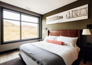 A bed or beds in a room at Origin Red Rocks, a Wyndham Hotel