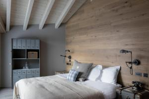 A bed or beds in a room at CERVO Mountain Resort