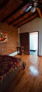 A bed or beds in a room at La Viña de OsCar