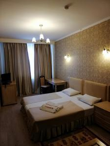 A bed or beds in a room at O Azamat