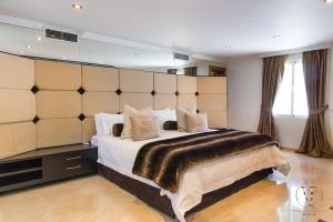 Cama o camas de una habitación en Villa Issabella