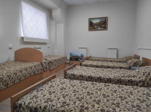 Кровать или кровати в номере Мотель Союз