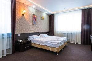 Кровать или кровати в номере Загородный Клуб Олимпия