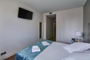מיטה או מיטות בחדר ב-Sensation Sagrada Familia