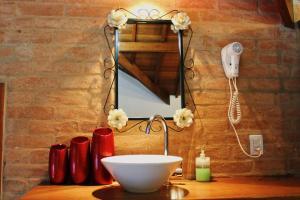 Um banheiro em Vivie Pousada