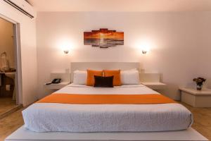 A bed or beds in a room at La Vue Boutique Inn