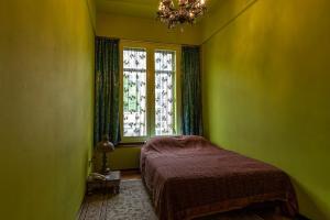 Een bed of bedden in een kamer bij Hotel Bazar