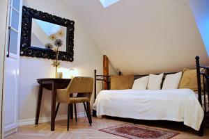 Lova arba lovos apgyvendinimo įstaigoje Apartments Satva
