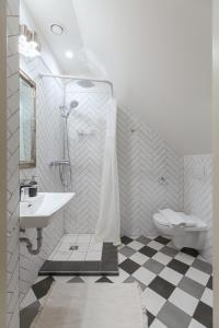 Vonios kambarys apgyvendinimo įstaigoje Apartments Satva