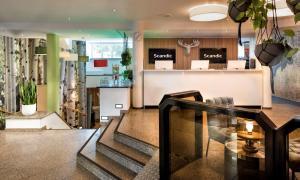 The lobby or reception area at Scandic Berlin Kurfürstendamm