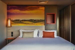Cama ou camas em um quarto em Novotel Itu Terras de Sao Jose Golf & Resorts