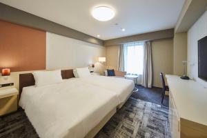 Ein Bett oder Betten in einem Zimmer der Unterkunft Richmond Hotel Narita