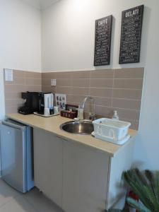 A kitchen or kitchenette at Serenity on the Lake - Maroochydore