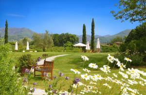 A garden outside Monsignor Della Casa Country Resort & Spa