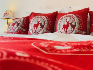 Un ou plusieurs lits dans un hébergement de l'établissement Hôtel de charme la Poste