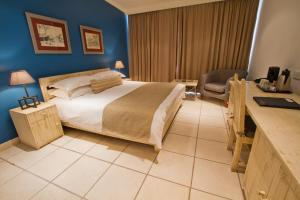 A bed or beds in a room at Protea Hotel by Marriott Chingola