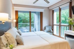 Cama o camas de una habitación en Hotel Monte Ulia