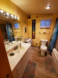 A bathroom at Cozy Sedona Cottage with Private Creek Access