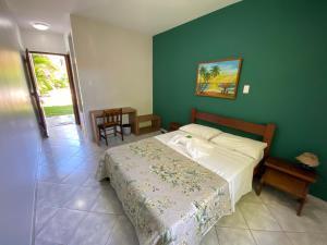 Cama ou camas em um quarto em Pousada-Zen Bougainville