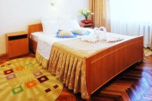 A bed or beds in a room at Profssoyuzny Hotel