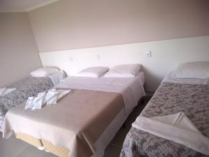 A bed or beds in a room at Hotel Jardim do Mar