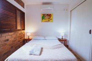Cama ou camas em um quarto em Pousada Alto do Cajueiro