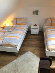 Ein Bett oder Betten in einem Zimmer der Unterkunft Ferienwohnung Giese