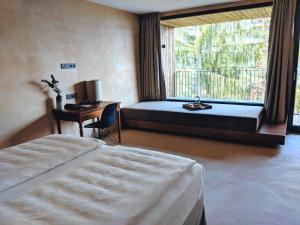 Ein Bett oder Betten in einem Zimmer der Unterkunft Saltus