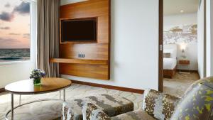 A television and/or entertainment center at OZO Colombo