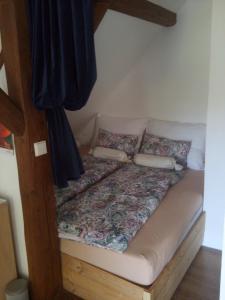Postel nebo postele na pokoji v ubytování BioFarma Dolejší Mlýn