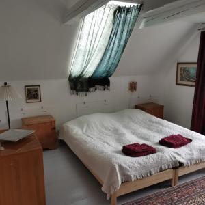 En eller flere senge i et værelse på Mikrogaarden