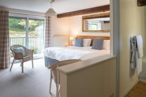 A bed or beds in a room at Cottesmore Hotel Golf & Country Club