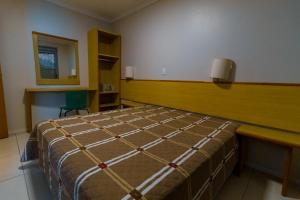 A bed or beds in a room at A Furninha Suites