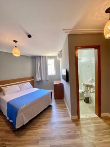 A bed or beds in a room at Hotel Porto Salvador