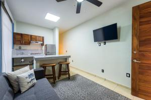 A television and/or entertainment center at Punto Mita Suites